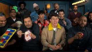 """Jonas Brothers join Jimmy and The Roots to perform their hit """"Sucker"""" with classroom instruments."""