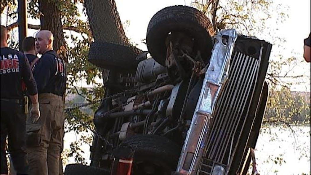 Pickup Truck Rolls Over Onto Riverside Jogging Trail