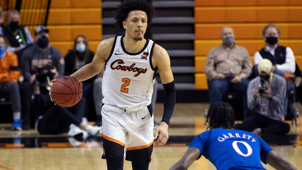Oklahoma State's Cade Cunningham (2) brings the ball up the co